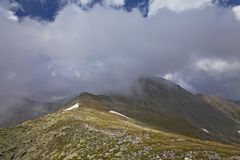 Dramatic cloud scenery in high mountains Royalty Free Stock Image