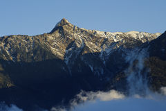 Dramatic cloud with snow peak in yushan. Royalty Free Stock Photos
