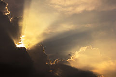 Dramatic cloud sunset time with sunbeams royalty free stock images