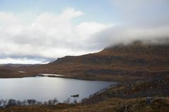 Dramatic clouded scottish scenery Stock Images