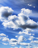 Dramatic clouds. On blue sky background stock photography