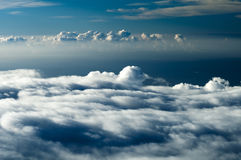 Dramatic Clouds. Dark heavenly clouds in the sky. This photograph was taken at 10,000 feet elevation and shows the clouds forming in a more dramatic way Stock Images