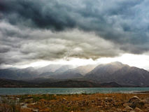 Dramatic clouds above lake near Mendoza in Argentinian Andes Royalty Free Stock Photo