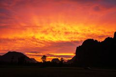 Dramatic clouds above a limestone mountain range, colorful ripple clouds on sunset sky, fantastic winter scene in North Laos. Dramatic clouds above a limestone stock images