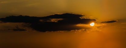 Dramatic clouds during amazing sunset in down Royalty Free Stock Photos