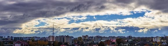 Dramatic clouds around the city. Rays of the sun make their way through dramatic clouds, located by a ring, over the city of Ivano-Frankivsk, Ukraine Royalty Free Stock Photos