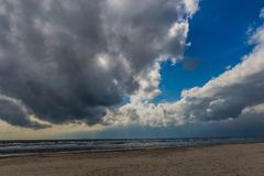 Dramatic clouds. Black Sea on a cloudy day. Dramatic Blue Sky and Clouds over the Sea. Black Sea on a cloudy day. Sea and sand stock photography