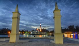 Dramatic clouds during blue hours. View of dramatic clouds during blue hours near the floating mosque also known as Tengku Zaharah mosque.Framing with two stoned Stock Photography