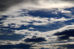 Dramatic clouds on blue sky background Stock Photos