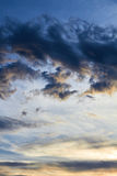 Dramatic clouds. In the blue sky that can be used as a vertical background and in different other projects Royalty Free Stock Photography
