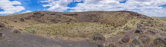 Dramatic clouds and blue sky. Panorama, Crater of extinct volcano, , Diamond Craters Outstanding Natural Area, Malheur, Oregon Stock Photo