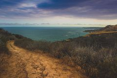 Corral Canyon Malibu Trail. Dramatic clouds and coastline view of the Pacific Ocean from the Corral Canyon trail in Malibu, California Stock Images