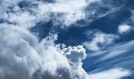 Dramatic clouds on dark blue sky Stock Images