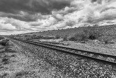 Dramatic Clouds and Empty Rails in Desert Royalty Free Stock Images