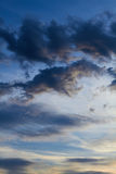 Dramatic clouds in the evening sky. That can be used as a vertical background and in different other projects Royalty Free Stock Photography