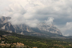 Dramatic clouds in mountains. Crimean mountain rocks in dramatic rainy clouds Royalty Free Stock Photography