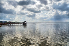 Dramatic clouds over the bay. Dramatic cumulus clouds over the Laguna Madre Bay, South Padre Island, Texas. A large flock of ducks is on the water Royalty Free Stock Images