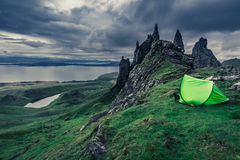 Dramatic clouds over campsite in Old Man of Storr in Scotland Stock Images