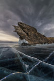 Dramatic clouds over a cliff on Lake Baikal. Stock Photos