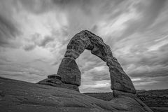 Dramatic clouds over Delicate Arch in Utah. A long exposure of ominous clouds over Delicate Arch in Arches National Park, Utah Stock Images