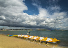 Dramatic clouds over a Dorset beach Royalty Free Stock Images