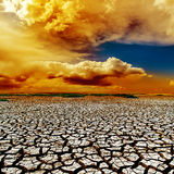 Dramatic clouds over drought earth Stock Photo