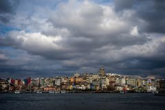 Dramatic clouds over Galata Tower in Istanbul Cityscape stock photography