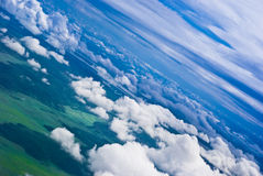 Dramatic of clouds over green fields. And forests. Aerial view Stock Image