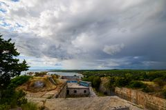 Dramatic clouds over the landscape of croatia with rain in the distance. Dramatic clouds over the landscape of croatia in an old fort with rain in the distance Royalty Free Stock Photos