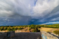 Dramatic clouds over the landscape of croatia with rain in the distance. Dramatic clouds over the landscape of croatia in an old fort with rain in the distance Stock Images