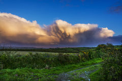 Dramatic clouds over mount st michael at Cornwall. Dramatic clouds over mount st michael island fortress near penzance at Cornwall Stock Images