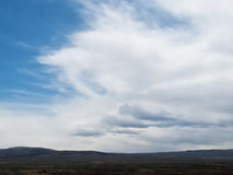Dramatic clouds over a mountain landscape. A variety of dramatic clouds fill the sky over a desert mountain landscape Stock Photography