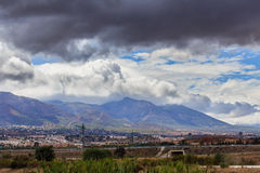 Dramatic clouds over mountains Stock Photo