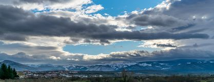 Panorama of Sibiu& x27;s suburb with mountains in background and dram stock photos
