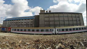 Dramatic clouds over the old derelict warehouse of train statition stock footage