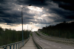 Dramatic clouds over a Polish road Stock Photo