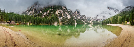 Dramatic clouds over Pragser Wildsee in Dolomites Royalty Free Stock Image