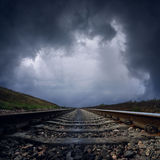 Dramatic clouds over railroad Royalty Free Stock Photos