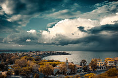 Dramatic clouds over the sea. And peninsula in sozopol, bulgaria Royalty Free Stock Photos