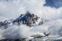 Dramatic clouds and peaks in the Alps Royalty Free Stock Photography