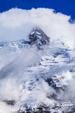 Dramatic clouds and peaks in the Alps Royalty Free Stock Image
