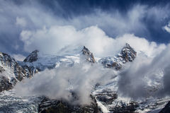 Dramatic clouds and peaks in the Alps Royalty Free Stock Photo
