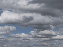 Dramatic clouds in the sky, cloudy skies with misty haze. Stock Photos