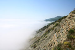 Dramatic clouds in sky. Fog Stock Photography