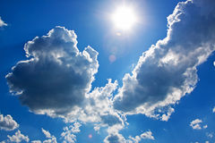 Dramatic clouds and sun Stock Images