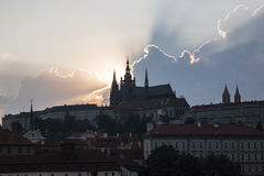 Dramatic Clouds And Sun Rays Above The Prague City Stock Photo