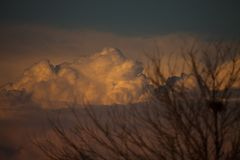 Dramatic Clouds at sunset. Dramatic clouds on mountains royalty free stock photography