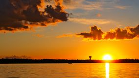 Dramatic clouds and sunset over lake in Bemidji Minnesota. Dramatic clouds and sunset over Lake Irving in Bemidji Minnesota stock photo