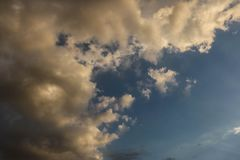 Dramatic Clouds under Blue sky. Thunderstorm and dramatic clouds over Dubai, UAE. Scenic view of evening sky stock photography