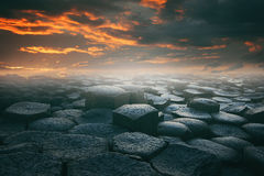 Dramatic Cloudscape And Stone Beach Royalty Free Stock Image